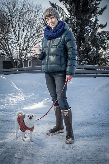 Ashley Kellum and her ferocious dog, Pika, at the corner of 13th and G Streets, in Anchorage's South Addition neighborhood. (Clark James Mishler)