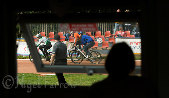 13 SEP 2014 - IPSWICH, GBR - A volunteer watches racing at the  2014 British Open Club Cycle Speedway Championships from the club hut at Whitton Sports & Community Centre in Ipswich, Great Britain  (PHOTO COPYRIGHT © 2014 NIGEL FARROW, ALL RIGHTS RESERVED) (NIGEL FARROW/COPYRIGHT © 2014 NIGEL FARROW : www.nigelfarrow.com)