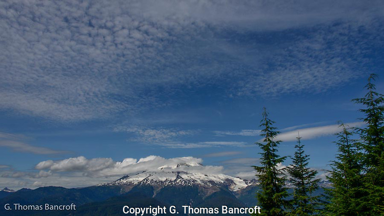 Clouds were drifting across Mt Baker as I climbed toward the Watson Lakes trail head. (G. Thomas Bancroft)