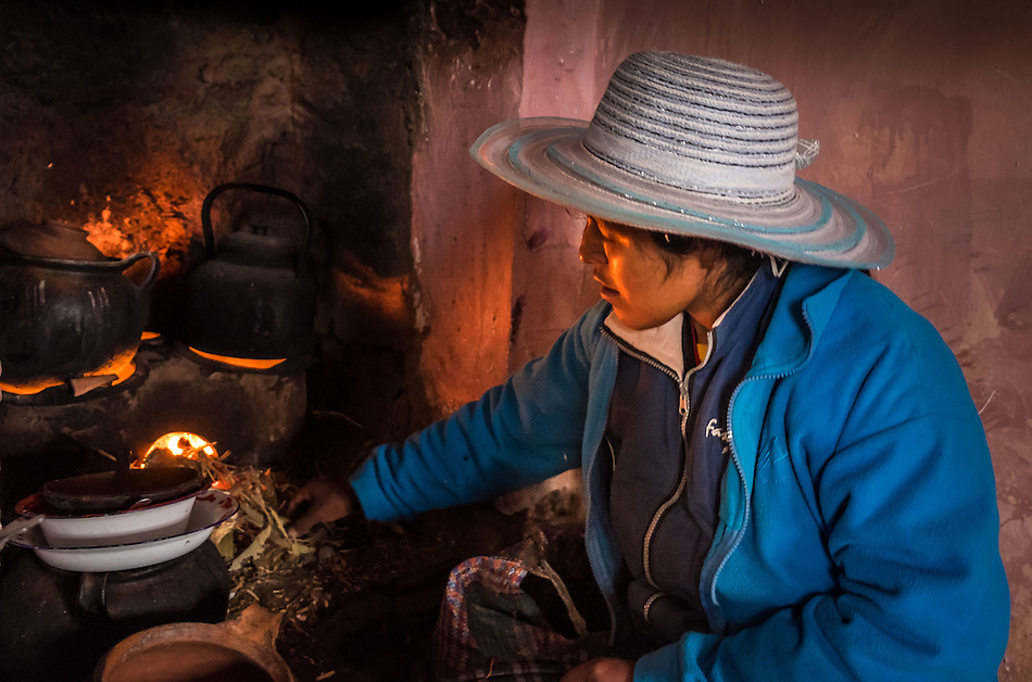 AMANTANI ISLAND, PERU - CIRCA APRIL 2014: Inhabitant of Amantani preparing food in a typical kitchen in a guest house of the Island. (Daniel Korzeniewski)