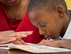 Read Houston Read volunteer Fatima Barnett works with a student at Woodson Elementary School, November 18, 2014. (Houston ISD/Dave Einsel)