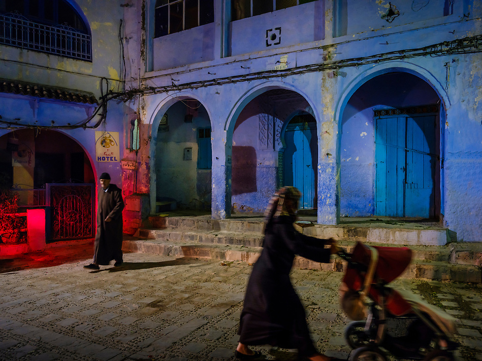 CHEFCHAOUEN, MOROCCO - CIRCA APRIL 2017: People walking by a square in Chefchaouen at night. This is a popular tourist destination in Morocco. (Daniel Korzeniewski)