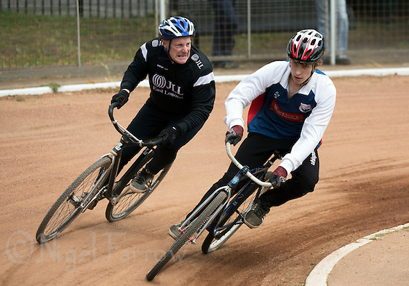 21 JUN 2015 - LONDON, GBR - Charlie Rumbold (right) of Ipswich Eagles attempts to fend off a challenge from Les Stevens of East London during their South East League One cycle speedway fixture at Canning Town Recreation Ground in London, Great Britain (PHOTO COPYRIGHT © 2015 NIGEL FARROW, ALL RIGHTS RESERVED) (NIGEL FARROW/COPYRIGHT © 2015 NIGEL FARROW : www.nigelfarrow.com)