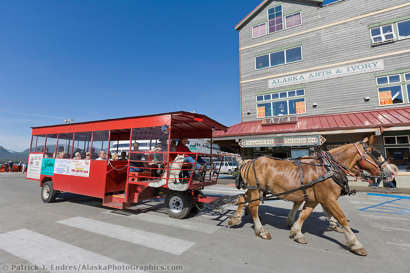 Horse drawn trolley transports tourists in downtown, Ketchikan, Alaska. (Patrick J. Endres / AlaskaPhotoGraphics.com)