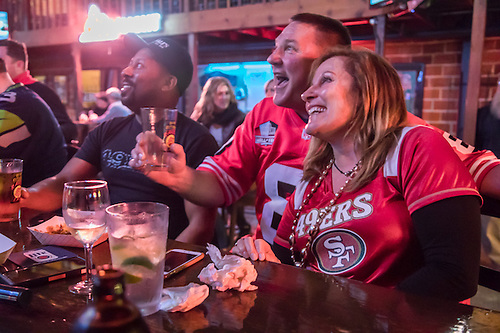 Locals Bill Powell, Chris McAllister and Dana Tanner Powell celebrate on Super Bowl Sunday at Susie's Bar on Lincoln Avenue in Calistoga (© 2017 Clark James Mishler)