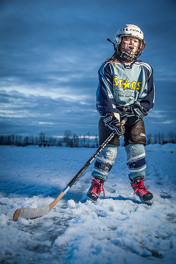 Hannah Katchen suits up in her hockey uniform on her 7th birthaday at Westchester Lagoon, Anchorage (Clark James Mishler)