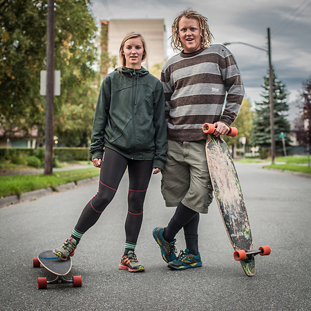 UAA Student Kayla Fry and recent graduate Guy Eriksen with their long boards on G Street, South Addition, Anchorage (Clark James Mishler)