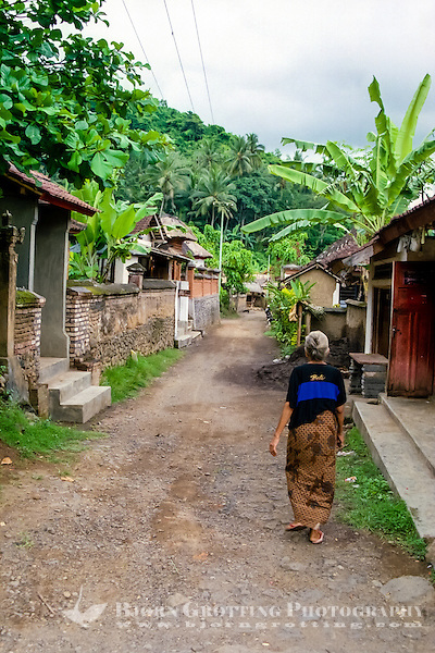 Bali, Karangasem, Tenganan. A traditional Bali Aga village. Tenganan is located on the fertile hills stretching up to Gunung Agung. An old woman in a Tenganans street. (Photo Bjorn Grotting)