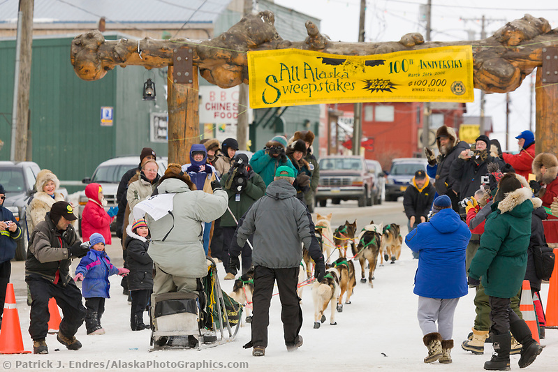 Kotzebu Musher Ed Iten arrives at the finish line in Nome in 5th place during the 2008 All Alaska Sweepstakes sled dog race. (Patrick J. Endres / AlaskaPhotoGraphics.com)