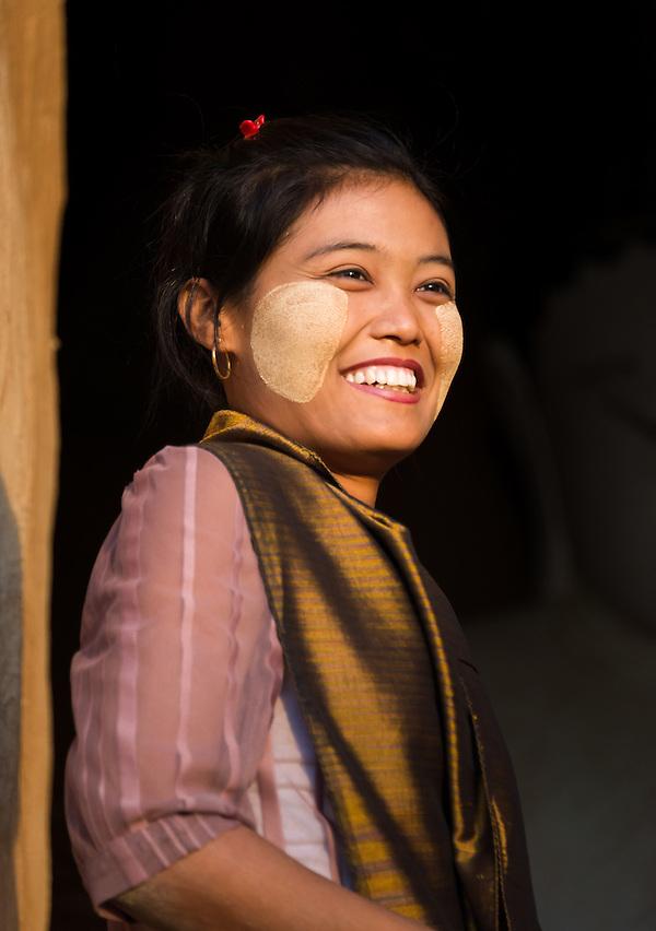 BAGAN, MYANMAR - CIRCA DECEMBER 2013: Young Burmese woman smiling in Bagan (Daniel Korzeniewski)