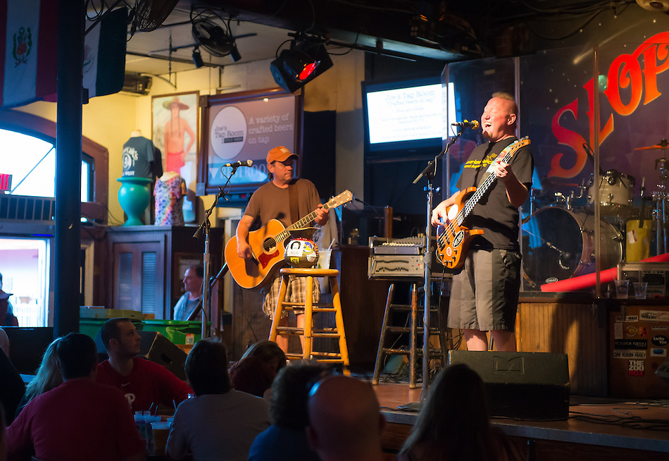 KEY WEST, FL - CIRCA 2012: Band playing in Slopppy Joe's Bar in Key West circa 2012. The tropical city is a popular tourist destination with over 2 million yearly visitors. (Daniel Korzeniewski)