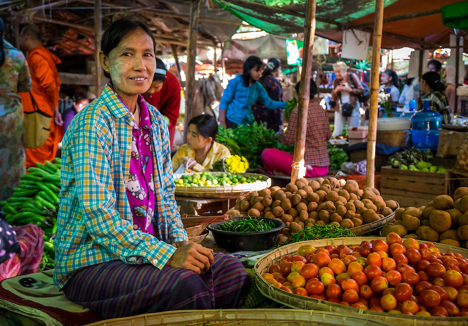 BAGAN, MYANMAR - CIRCA DECEMBER 2013: Woman selling vegetables in the Nyaung U market close to Bagan in Myanmar (Daniel Korzeniewski)