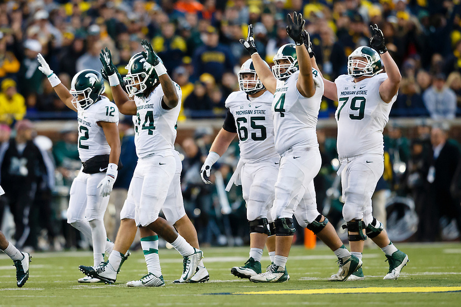 Oct 17, 2015; Ann Arbor, MI, USA; Michigan State Spartans celebrate in the third quarter against the Michigan Wolverines at Michigan Stadium. Mandatory Credit: Rick Osentoski-USA TODAY Sports3 (Rick Osentoski/Rick Osentoski-USA TODAY Sports)