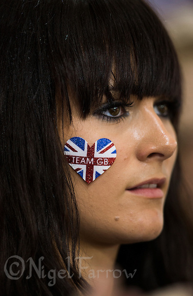 03 AUG 2012 - LONDON, GBR - Zoe Burke watches as her brother Steven Burke receives his gold medal after the Great Britain team won the Team Pursuit final at ... - burke-zoe0308121174ps
