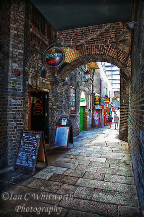 A view under the sheltered area across from the Ha'penny Bridge in Dublin that houses the Merchant's Arch Bar & Restaurant. (Ian C Whitworth)