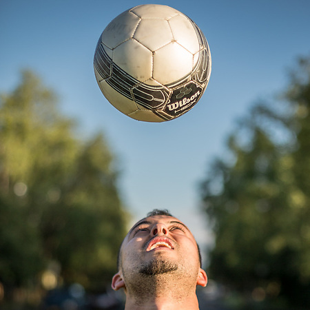 "Juan Mejia practices with his soccer ball on the Delaney Park Stirp.  ""I am from Venezula and I've been here nine years.  I love it here and I'm never going back."" (© Clark James Mishler)"