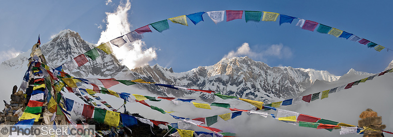 Prayer flags express compassion at this monument to fallen climbers, at Annapurna South Base Camp (ABC) in the Annapurna Range of Nepal.