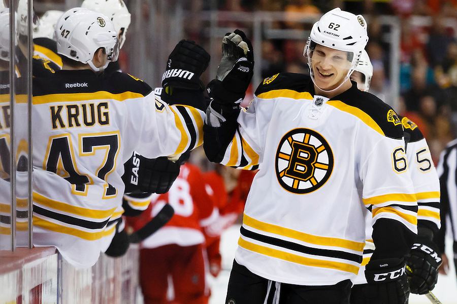 Apr 2, 2015; Detroit, MI, USA; Boston Bruins defenseman Zach Trotman (62) receives congratulations from teammates after scoring in the third period against the Detroit Red Wings at Joe Louis Arena. Boston won 3-2. Mandatory Credit: Rick Osentoski-USA TODAY Sports (Rick Osentoski/Rick Osentoski-USA TODAY Sports)