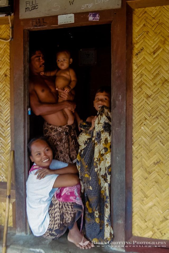 Nusa Tenggara, Lombok, Sade. Sade village. A Sasak family in a traditional Sasak house  . (Bjorn Grotting)