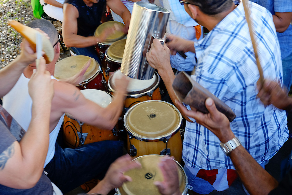MIAMI - MARCH 9, 2014: Band playing music in the streets of calle 8 during the  37th Calle Ocho festival, an annual event that takes place over Eighth Street in Little Havana featuring plenty of music, food, and  it is the biggest party in town that celebrates hispanic heritage. (Daniel Korzeniewski)