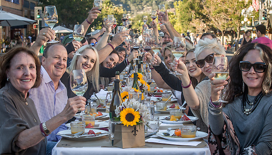 Susan Baxter (far right) and friends toast at the start of annual Harvest Table celebration on Lincoln Avenue in downtown Calistoga, CA (Clark James Mishler)