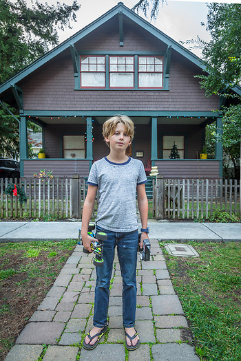 """My friend, Leo, also got a car for Christmas.  His is better off-road but mine is better at speed.""    -Ten year old Calistoga resident Oscar Brown stands in front of his house on Cedar Street after returning from a test run with his remote control racing car. (Clark James Mishler)"