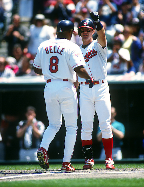 CLEVELAND - 1995:  Jim Thome #25 greets Albert Belle #8 of the Cleveland Indians after Belle hit a home run in an MLB game at Jacobs Field in Cleveland, Ohio.  Thome played for the Indians from 1991-2002.  Belle played for the Indians from 1989-1996.  (Photo by Ron Vesely) (Ron Vesely)