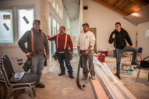 John Bowman Construction Company workers Jorge, Jose, Martin and Junior work on a new home at 1706 Myrtle Street in Calistoga (Clark James Mishler)
