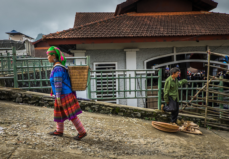 BAC HA, VIETNAM - CIRCA SEPTEMBER 2014:  Hmong woman walking at  Bac Ha sunday market, the biggest minority people market in Northern Vietnam (Daniel Korzeniewski)