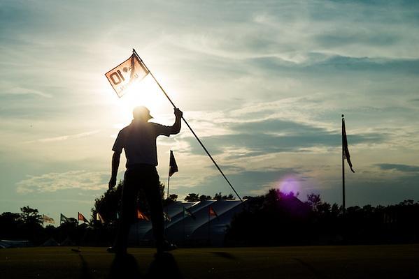 Mark Wilson places the hole flag at the practice green during a practice round before the 2014 U.S. Open at Pinehurst Resort & C.C. in Village of Pinehurst, N.C. on Monday, June 9, 2014.   (Copyright USGA/Darren Carroll) (Darren Carroll/USGA Museum)