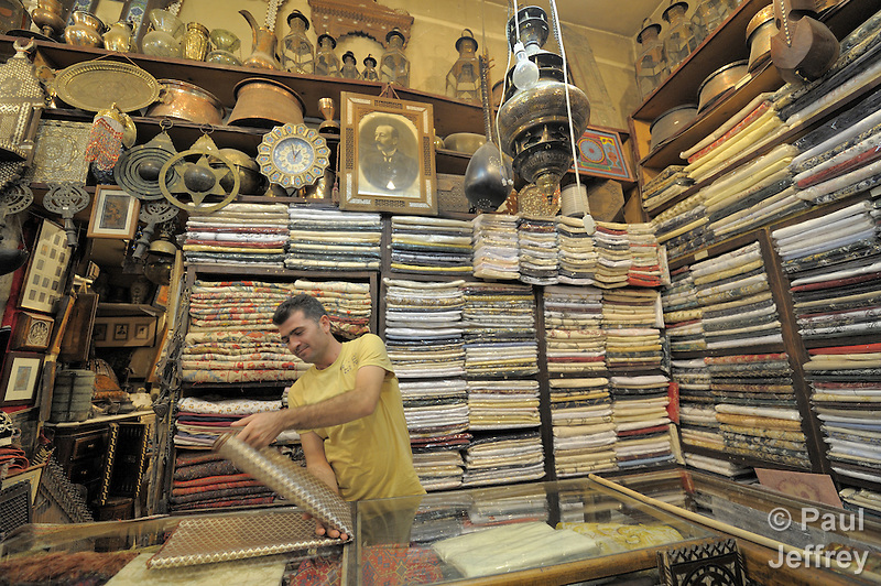 Brocade and other fine cloth for sale in the ancient George Dabdoub store in the Old City of Damascus, Syria. (Paul Jeffrey)
