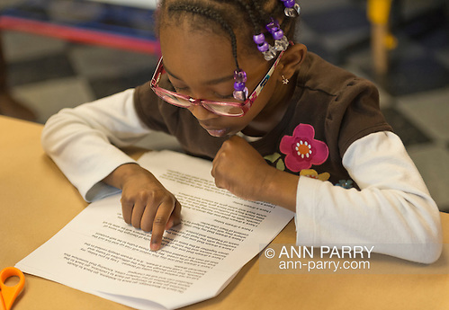 Garden City, New York, U.S. January 20, 2014. JAEL CHARLTON, 6, of Freeport, reads King's 1963