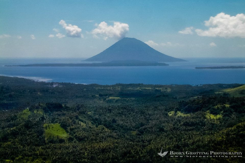Indonesia, Sulawesi, Bunaken. Bunaken and Manado Tua seen from airplane, close to Manado's airport. (Photo Bjorn Grotting)