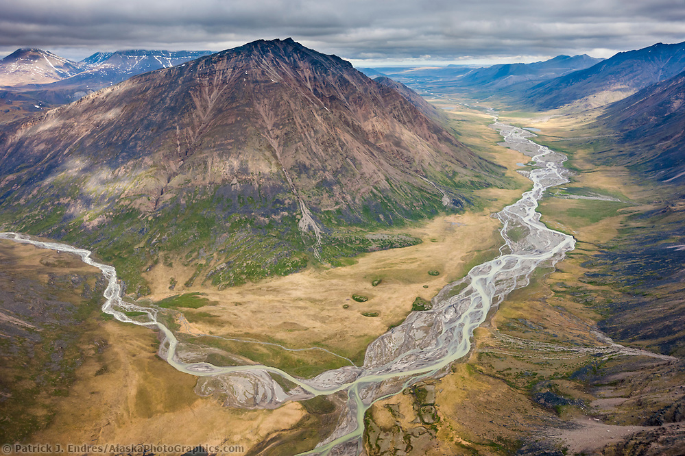 Okokmilaga river flows north out of the Brooks Range mountains, through the Gates of the Arctic National Park, Alaska. (Patrick J Endres / AlaskaPhotoGraphics.com)