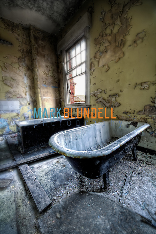 Dirty baths at Hellingly Asylum, East Sussex. (Mark Blundell)