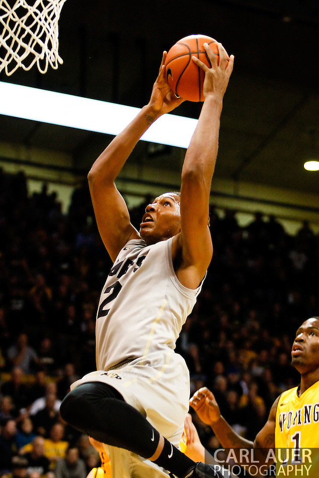 November 13th, 2013:  Colorado Buffaloes sophomore forward Xavier Johnson (2) elevates to the rim for a dunk in the first half of action in the NCAA Basketball game between the University of Wyoming Cowboys and the University of Colorado Buffaloes at the Coors Events Center in Boulder, Colorado (Carl Auer/ZUMAPRESS.com)