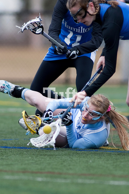 03/10/2012- Medford, Mass. - Tufts midfielder Casey Egan, A12, goes to the ground while fighting for a loose ball in Tufts 8-7 season opening win over Hamilton on Mar. 10, 2012. (Kelvin Ma/Tufts University) (Kelvin Ma/Tufts University)