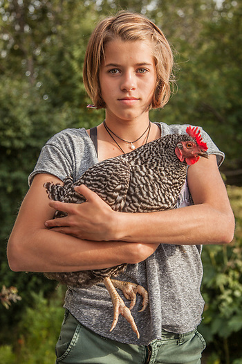 My 14 year old South Addition neighbor, Valerie with her chicken.  majanigo@gmail.com (© Clark James Mishler)