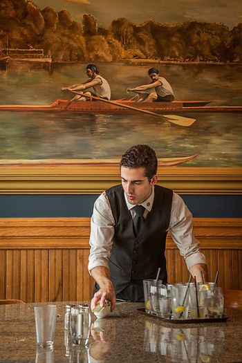 """I've worked here 3.5 years...its great fun.""  Cameron McCormick clears a table at Simon and Seaforts in downtown Anchorage.    cameronmmccormick@gmail.com (© Clark James Mishler)"