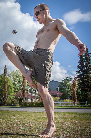 Noah Hagen and Bryce Peterson play Hacky Sack at the west end of the Delaney Park Strip on a beautiful Memorial Day in Anchorage.  bryce.peterson1@gmail.com (© Clark James Mishler)