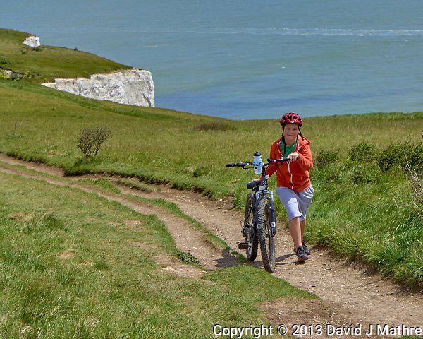 Walking a bicycle on a trail above the White Cliffs of Dover, England. (David J Mathre)