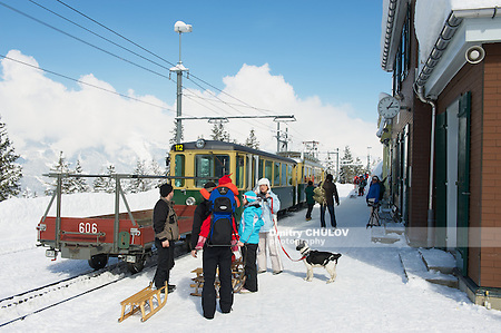 GRINDELWALD, SWITZERLAND – MARCH 07, 2009: Unidentified tourists wait for a train at Wengernalpbahn train station in Grindelwald, Switzerland. Grindelwald area is a famous ski resort in Switzerland. (Dmitry Chulov)