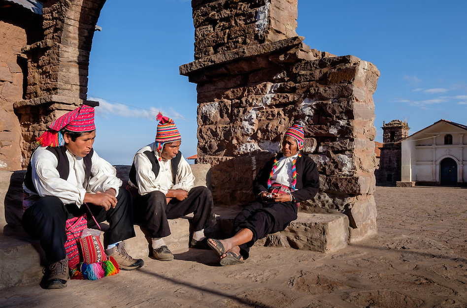 TAQUILE ISLAND, PERU - CIRCA OCTOBER 2015: Men having a conversation in Taquile Island main square, in Lake Titicaca, Peru. (Daniel Korzeniewski)