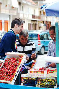 "Professor Dan Petek buying cherries from a street vendor in Naples Italy (© Daryl Hunter's ""The Hole Picture""/Daryl L. Hunter)"