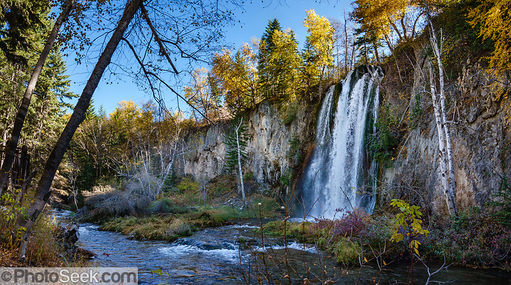 Little Spearfish Creek plunges over Spearfish Falls to meet the main Spearfish Creek. Multiple overlapping photos were stitched to make this panorama. (© Tom Dempsey / PhotoSeek.com)
