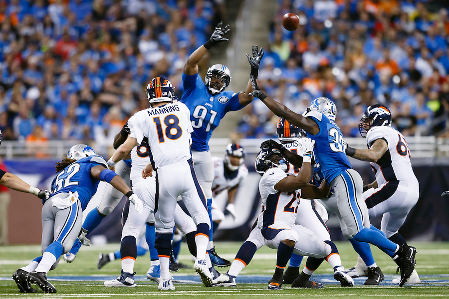 Denver Broncos quarterback Peyton Manning (18) passes over Detroit Lions defensive end Jason Jones (91) during an NFL football game at Ford Field in Detroit, Sunday, Sept. 27, 2015. (AP Photo/Rick Osentoski) (Rick Osentoski/AP)