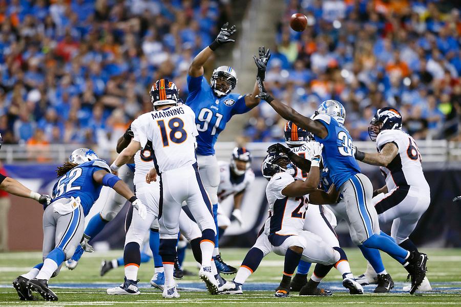 Denver Broncos quarterback Peyton Manning (18) passes over Detroit Lions defensive end Jason Jones (91) during an NFL football game at Ford Field in Detroit, Sunday, Sept. 27, 2015. (AP Photo/Rick Osentoski) (Rick Osentoski/AP)