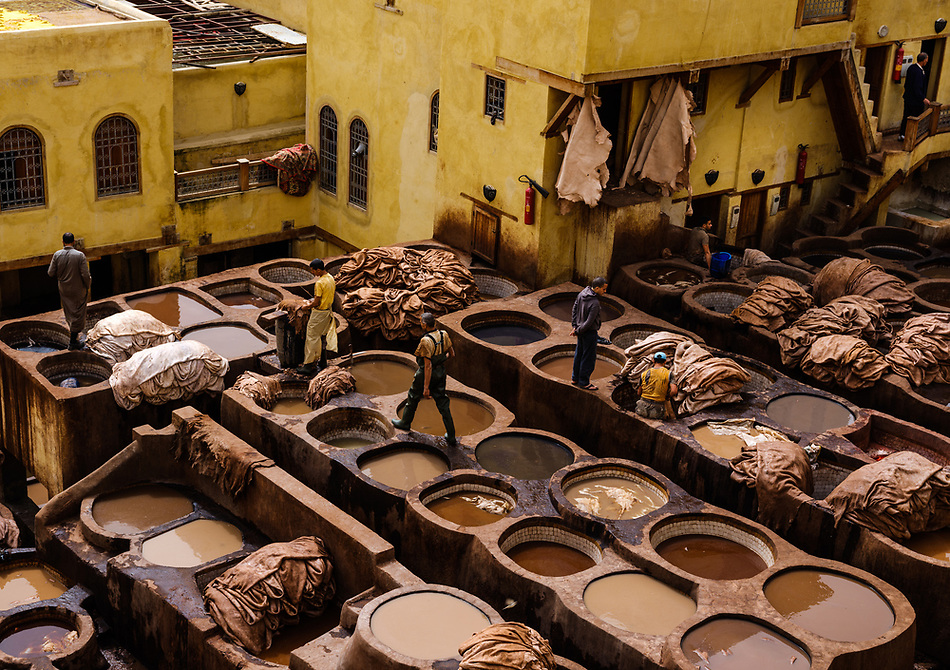 FEZ, MOROCCO - CIRCA APRIL 2017: View of the tannery and workers in Fez. (Daniel Korzeniewski)