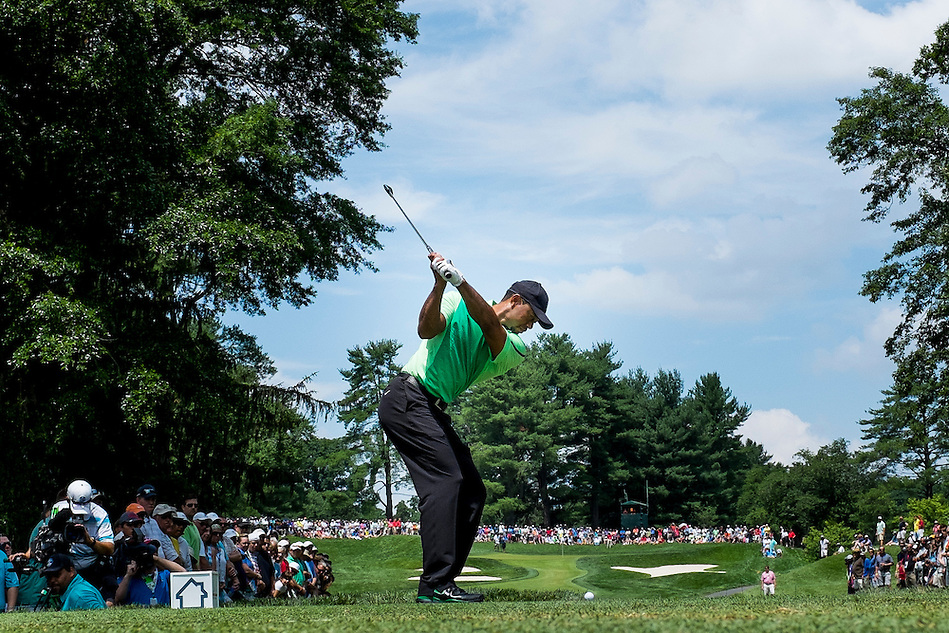 Tiger Woods tees off on the 7th hole during the first round of the Quicken Loans National golf tournament on Wednesday at Congressional Country Club in Bethesda, Maryland. This marked  Woods' return to competition for the first time in three months after having surgery just a week before the Masters in April of this year. (Pete Marovich/Corbis)