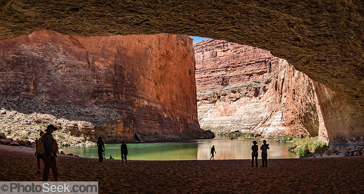 """Redwall Cavern at River Mile 33.3, seen while rafting through Marble Canyon on day 2 of 16 days boating 226 miles down the Colorado River in Grand Canyon National Park, Arizona, USA. Marble Canyon runs from Lees Ferry at River Mile 0 to the confluence with the Little Colorado River at Mile 62, which marks the beginning of the Grand Canyon. Although John Wesley Powell knew that no marble was found here when he named Marble Canyon, he thought the polished limestone looked like marble. In his words, """"The limestone of the canyon is often polished, and makes a beautiful marble. Sometimes the rocks are of many colors – white, gray, pink, and purple, with saffron tints."""" Multiple overlapping photos were stitched to make this panorama. (© Tom Dempsey / PhotoSeek.com)"""